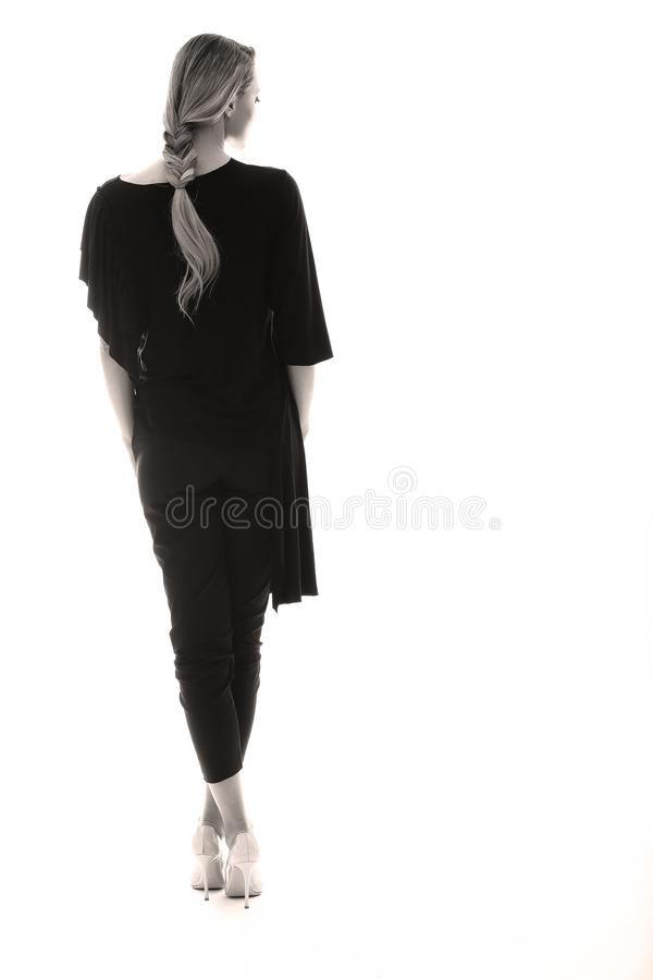 Elegante schwarze Ausstattung für Frauen, weißer Hintergrund stockbild