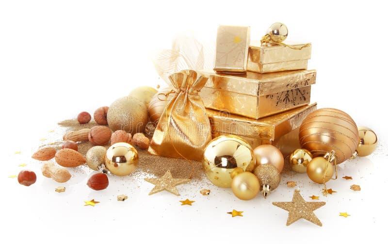 Elegante sortierte Goldweihnachtsdekorationen lizenzfreie stockfotos