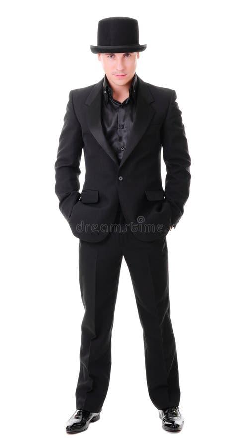 Eleganter junger Mann in voller Länge im schwarzen Anzug lizenzfreie stockbilder