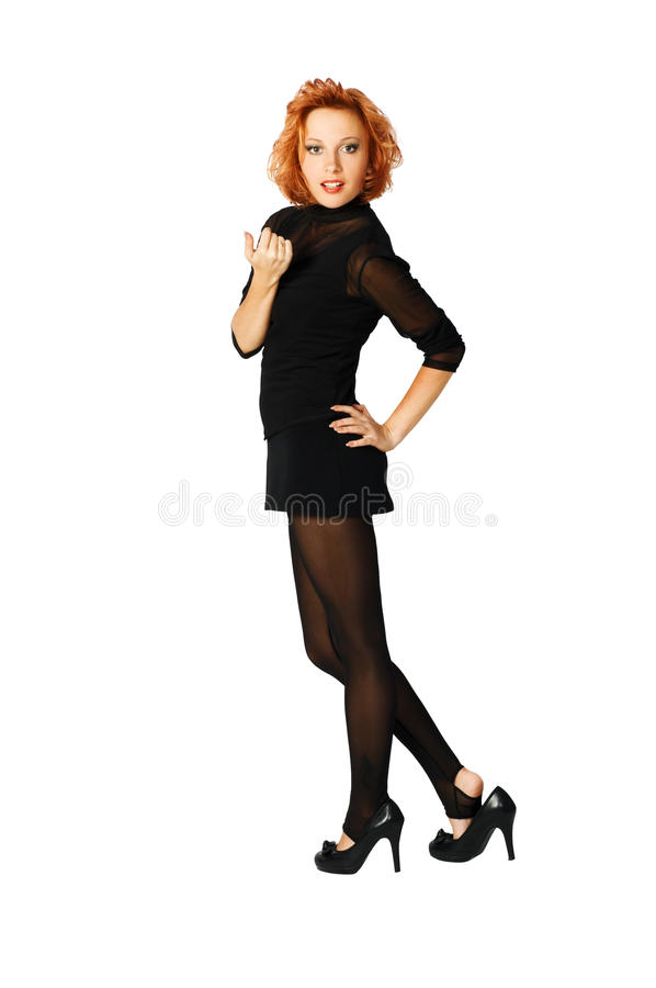 Elegantes red-haired Mädchen auf weißem Hintergrund stockbilder