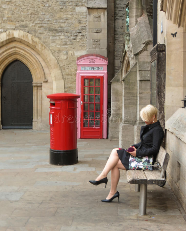 Elegantly dressed blonde lady sitting royalty free stock photos