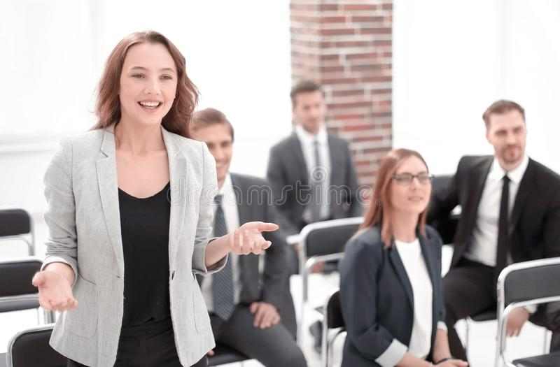 Beautiful business woman is speaking on conference. Elegantly dressed lady proposing her idea for company`s strategy stock images