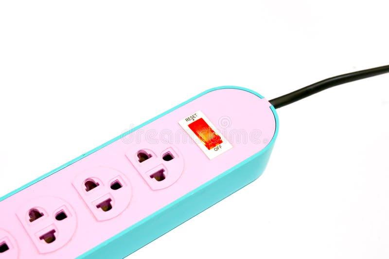 Elektriciteit thuis De machtsstrook van de pastelkleurafzet met schakelaar royalty-vrije stock foto's