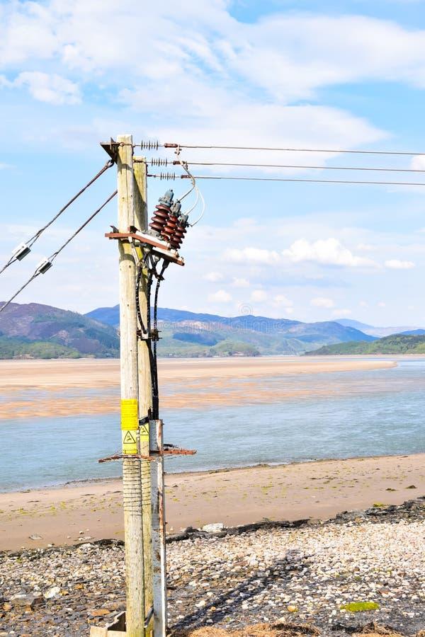 Elektriciteitspost op de kusten van Mawddach-rivier in Wales, het Verenigd Koninkrijk stock fotografie