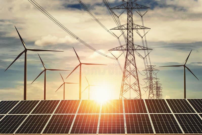 elektricitetsmakt i natur g?r ren begreppsenergi solpanel med turbin- och för solnedgång för tornhöjdspänning bakgrund arkivfoto