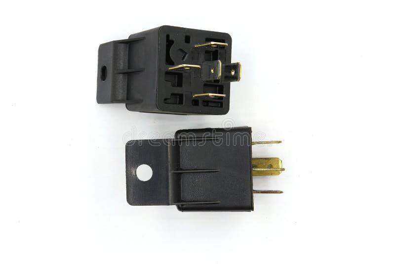 Elektrisch relais, Elektro Hulprelais, het Relais van de Rolmacht, magnetische schakelaar, het autodiedeel van 12v op witte achte royalty-vrije stock fotografie