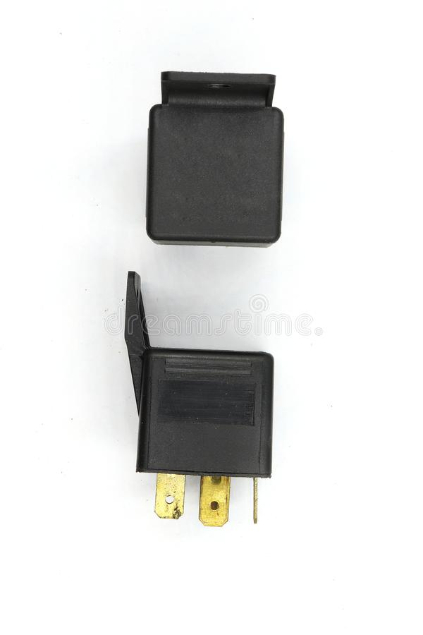 Elektrisch relais, Elektro Hulprelais, het Relais van de Rolmacht, magnetische schakelaar, het autodiedeel van 12v op witte achte stock afbeelding