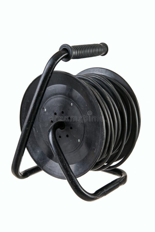Elektrische Drahterweiterungskabel auf einer Spule lokalisiert auf weißem Hintergrund stockbild