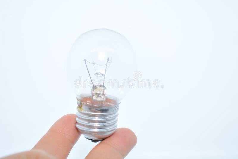 Elektrische Lampe auf der Hand stockbild