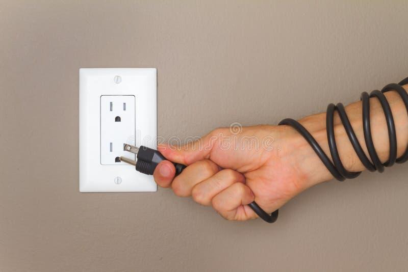 Elektrische Leitung auf der Hand stockfotos