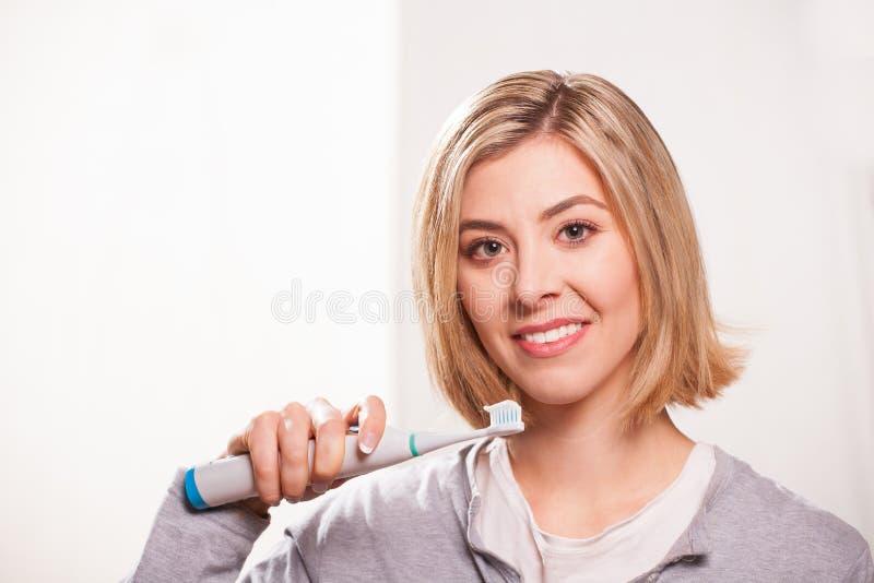 Elektrische tandenborstel stock afbeeldingen
