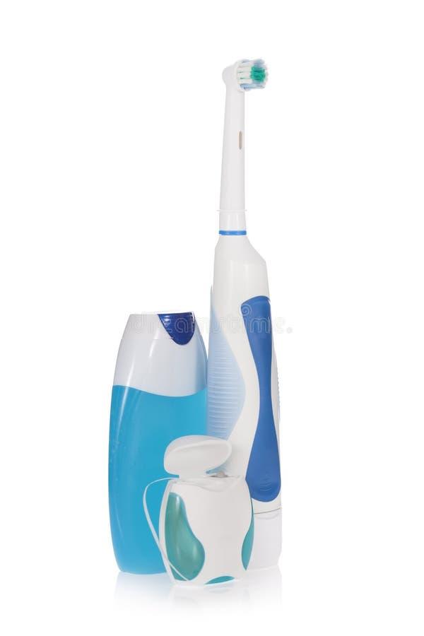 Elektrische tandenborstel, tandpasta en tandzijde royalty-vrije stock fotografie