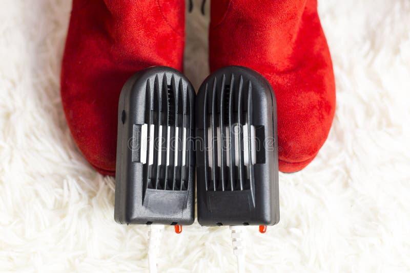 Elektrischer Trockner für Schuhe stockfoto