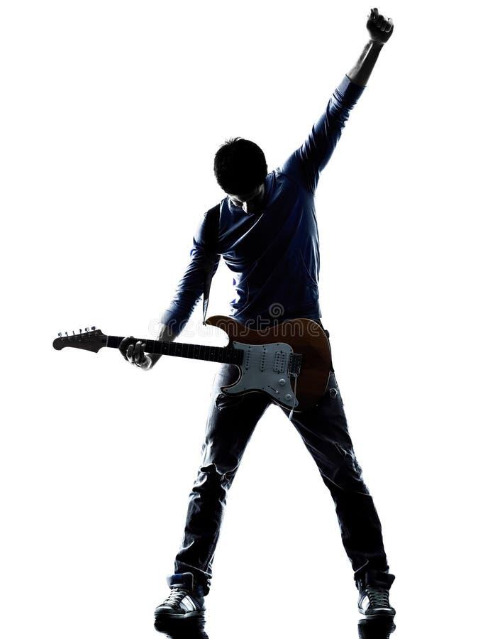 Elektrisk gitarristspelare för man som spelar konturn arkivfoton