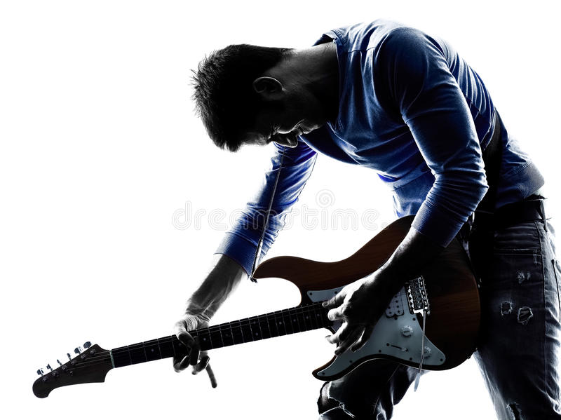 Elektrisk gitarristspelare för man som spelar konturn royaltyfri bild