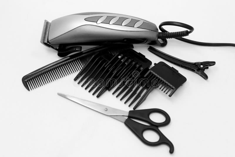Elektrisk hårclipper på en vit bakgrund arkivfoto
