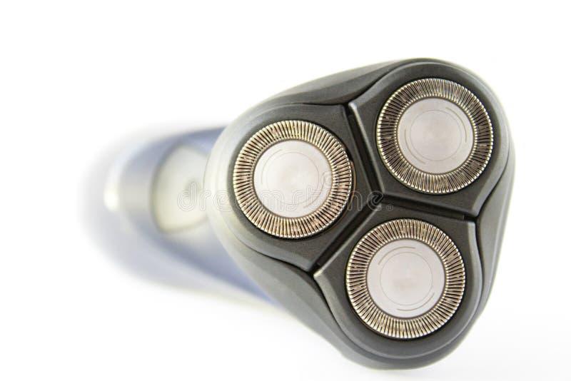 Elektrisk rakapparat för folknärbild på en vit bakgrund arkivfoto