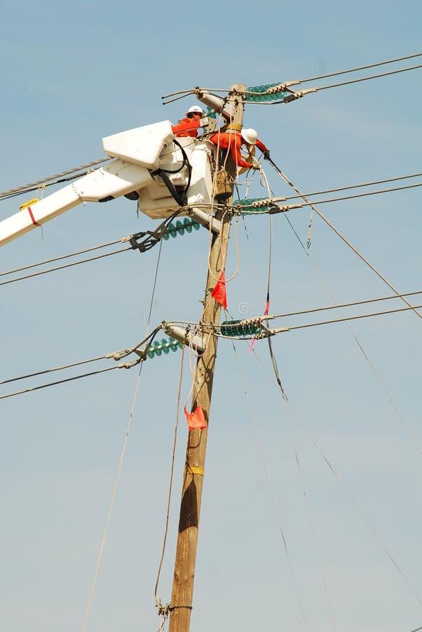 elektriska linjearbetare arkivbild