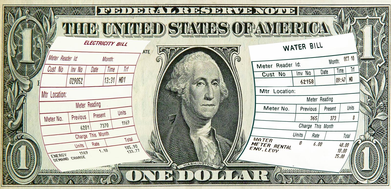 Elektrizität, Wasserrechnungen auf 1 Dollar US. Konzept stockbild