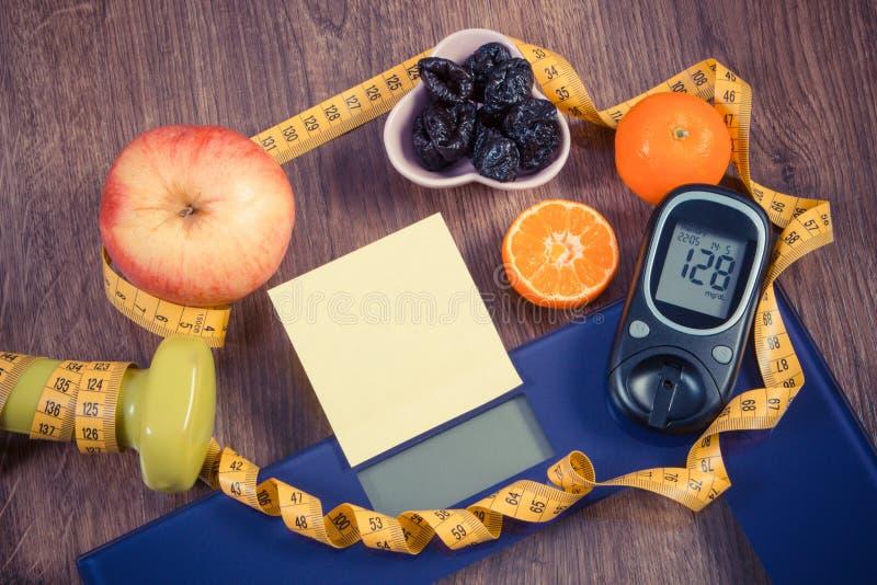 Elektronische badkamersschaal en glucometer met resultaat van meting, gezonde voedsel en domoren, gezonde levensstijlen, diabetes stock afbeeldingen