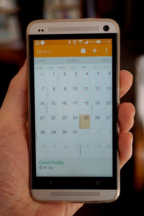 Elektronisk kalender i mobiltelefonorganisatören royaltyfria bilder