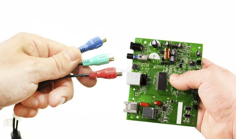 Elektronisk microcircuit och olika adapter royaltyfri fotografi