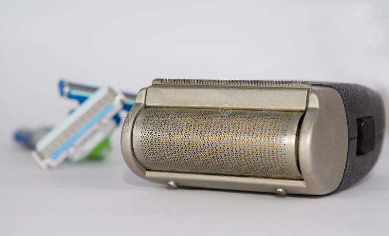 Elektroscheerapparaat en scheermessen royalty-vrije stock fotografie