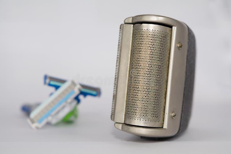 Elektroscheerapparaat en scheermessen stock fotografie
