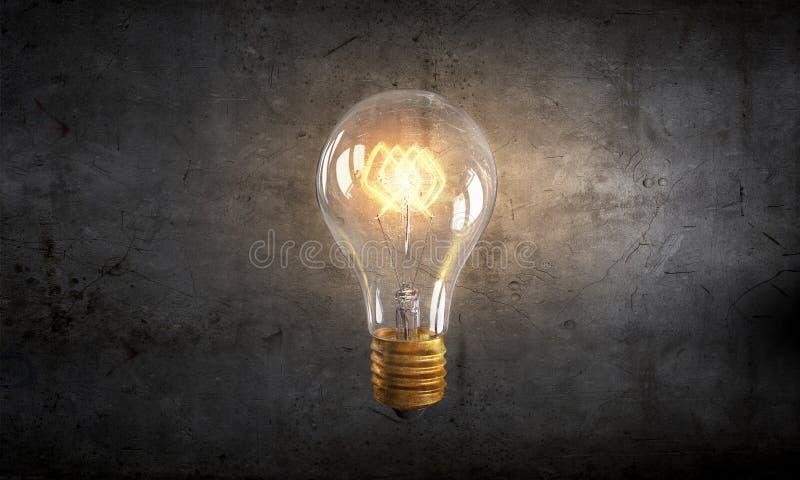 Elektryczna żarówka na teksturze obrazy royalty free