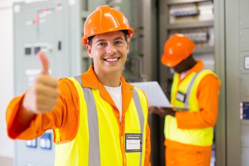 Elektrycznego inżyniera kciuk up zdjęcie stock