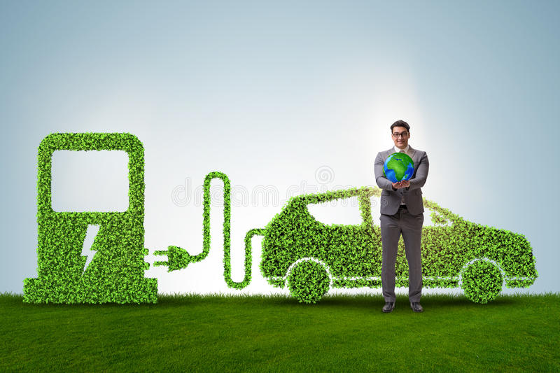 Elektrycznego samochodu pojęcie w zielonym środowiska pojęciu zdjęcia stock