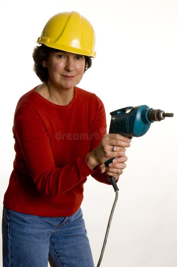 elektryczny świder kobieta obrazy stock