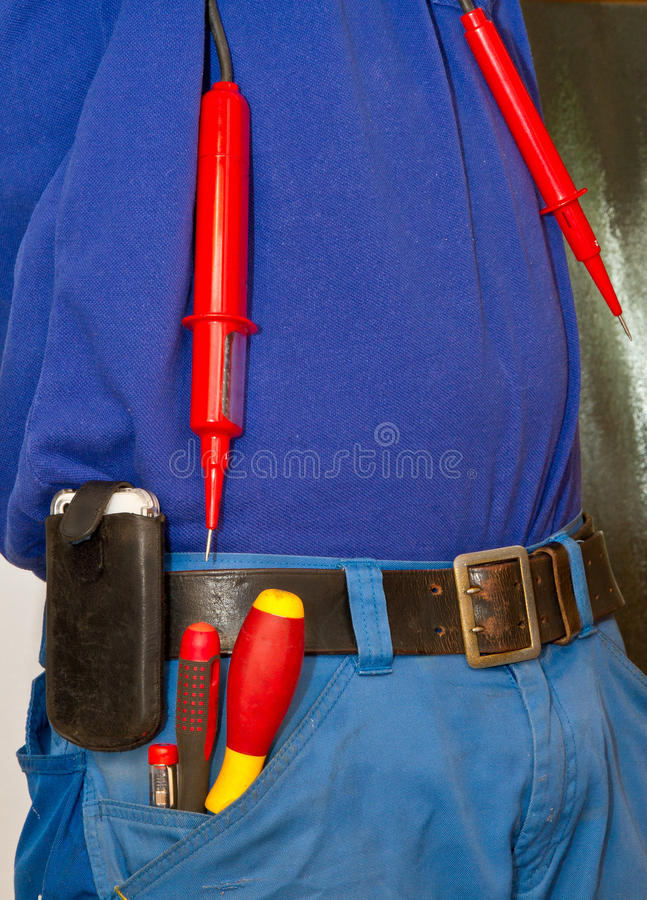Elelectrican. Electrician with various work tools royalty free stock photography