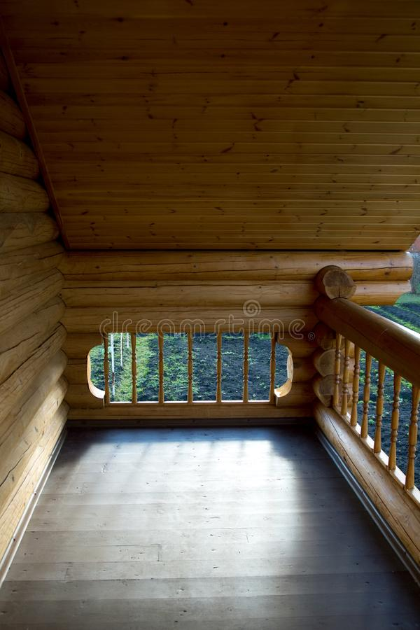Element of the balcony of the house from the Russian h. Ouse from round logs stock photos