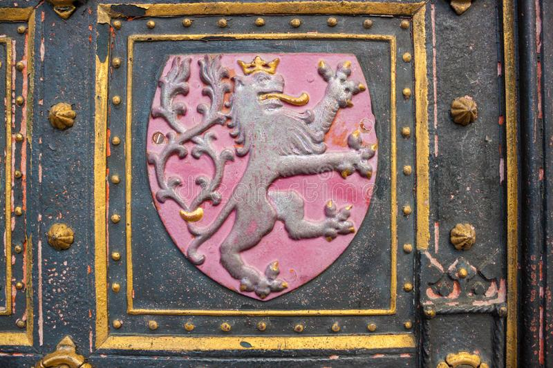 Lion - coat of arms of the Czech Republic on doors of St. Peter and St. Paul Basilica, Prague royalty free stock image
