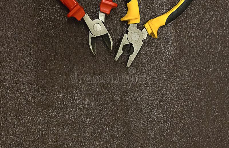 Element of electrician tools pliers cutting pliers at the top of the decoration frame background dark copy space royalty free stock images