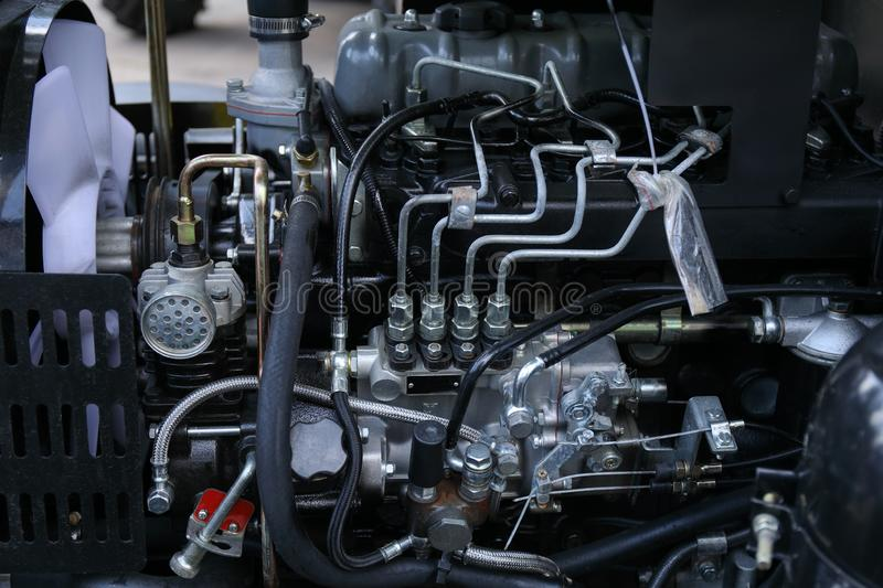 Element of engine system of new modern agricultural tractor or combine or harvester royalty free stock photography
