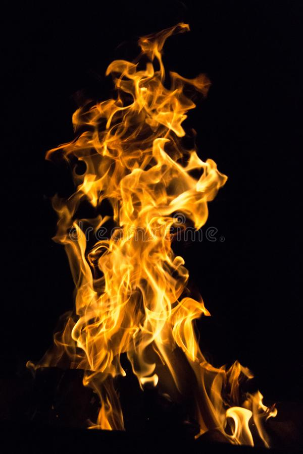 Element of fire. Devilish flame. The fire of hell. Background from dancing tongues of fire. Fire hazard. Fire safety. Passionate love. Bask around the campfire stock photos