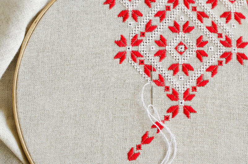 Element handmade embroidery by red and white cotton threads. Craft embroidery. stock photos