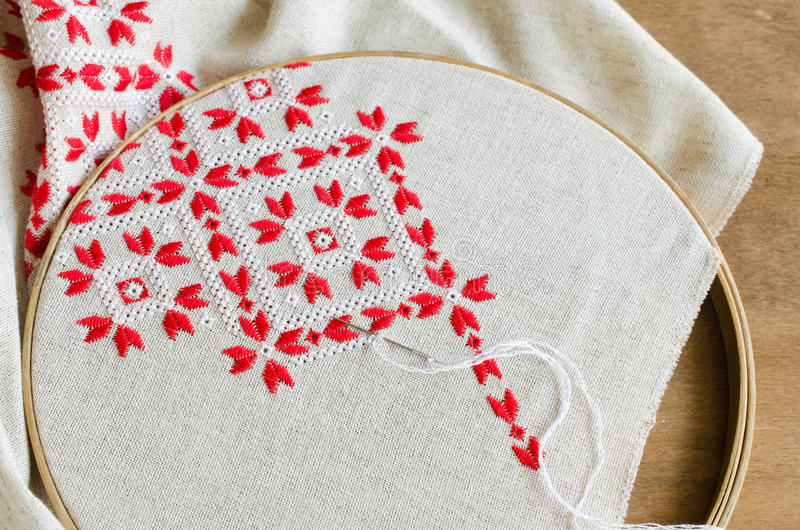Element handmade embroidery by red and white cotton threads. Craft embroidery. royalty free stock photography