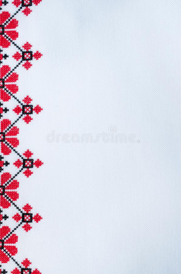 Element Handmade Embroidery on White Linen by Red and Black Cotton Threads. royalty free stock photo