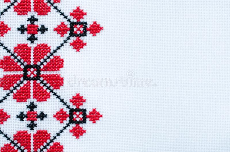 Element Handmade Embroidery on White Linen by Red and Black Cotton Threads. royalty free stock image