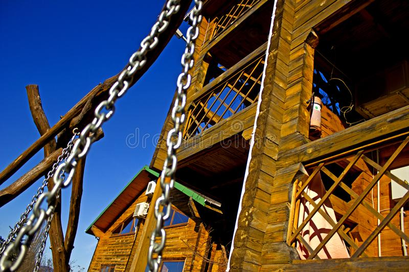 The element of the metal chain, as a decoration to the swings in the territory of the house for the rest. Metal chain on the street swing in the background of royalty free stock photo