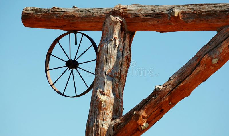 South Dakota element of the ranch gate. Old wagon wheel as element of the gate to the ranch we can see in South Dakota stock images