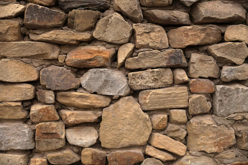 Element of a stone laying. House wall element revetted with a natural stone stock photo