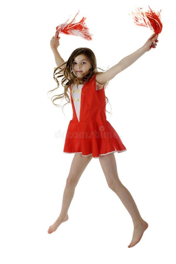 Elementary Cheerleading Jump stock image