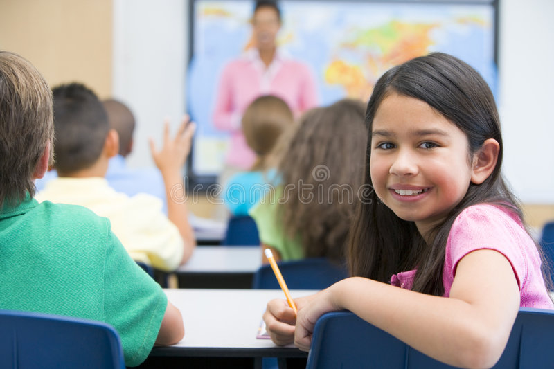 Elementary pupil in class royalty free stock photo