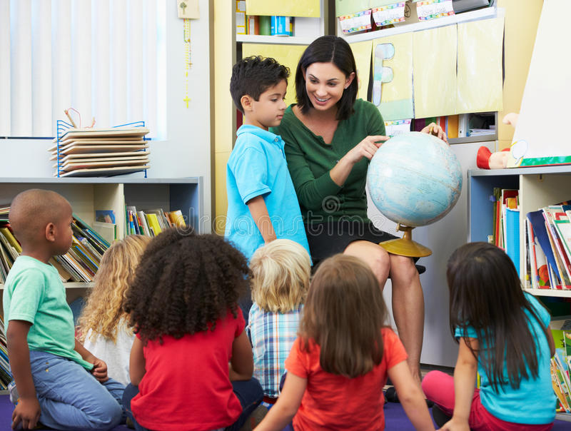 Download Elementary Pupils In Geography Class With Teacher Stock Photo - Image: 30879610