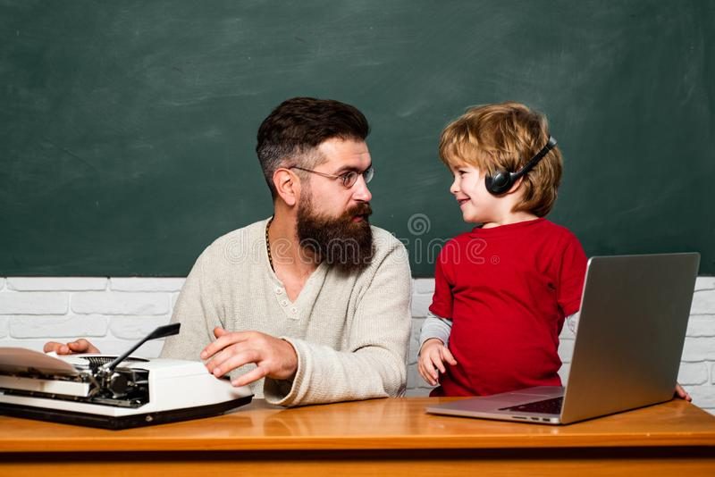 Elementary school. Copy space. Education and learning people concept - little student boy and Teacher. Father and son. Little students. School children. Daddy stock photography