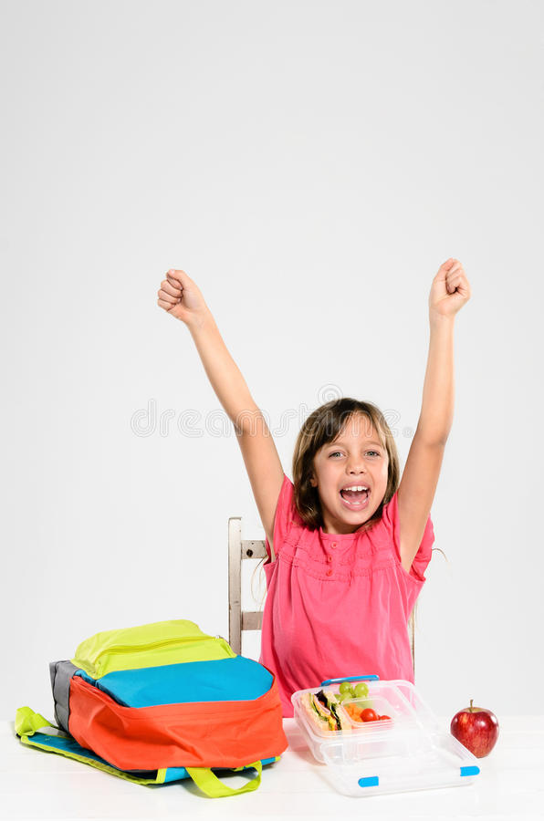 Elementary school girl celebrating her healthy lunch stock images